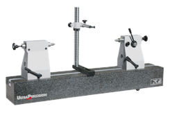 Concentricity tester with a granite bench incl. tailstocks and measuring stand. Flatness of the measuring bench according to DIN 876 Grade 1 up to 1600 mm length with T-slot for tailstock pair and measuring stand. Tailstocks optionally with or without hardened V blocks.